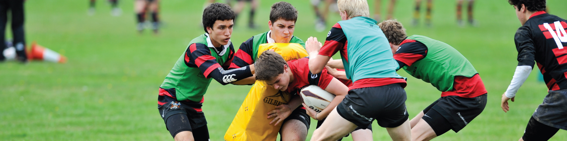 School boys in rugby tackle