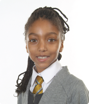 Smiling school girl with a traditional white school photography background
