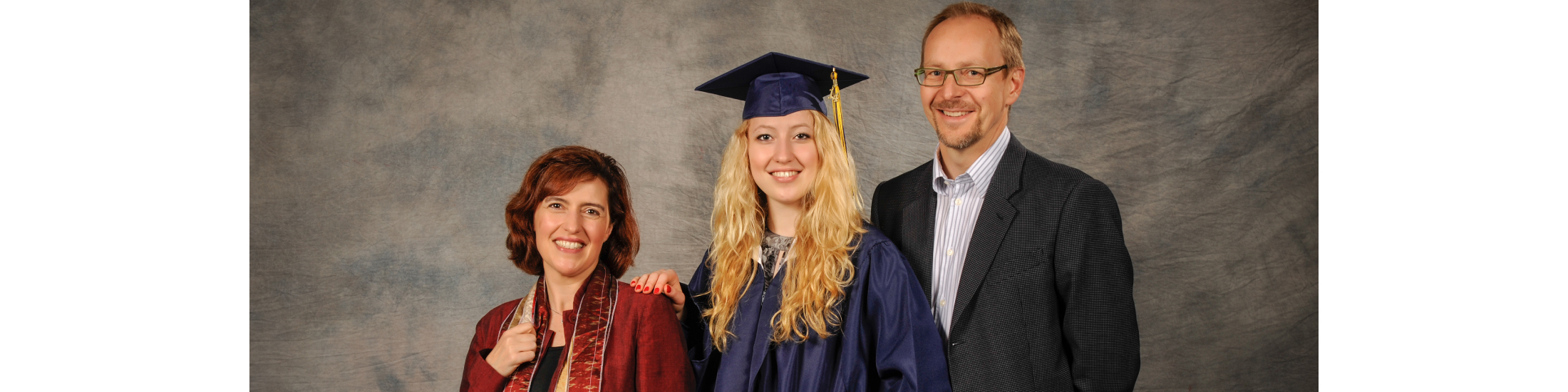 Photograph of graduate with parents