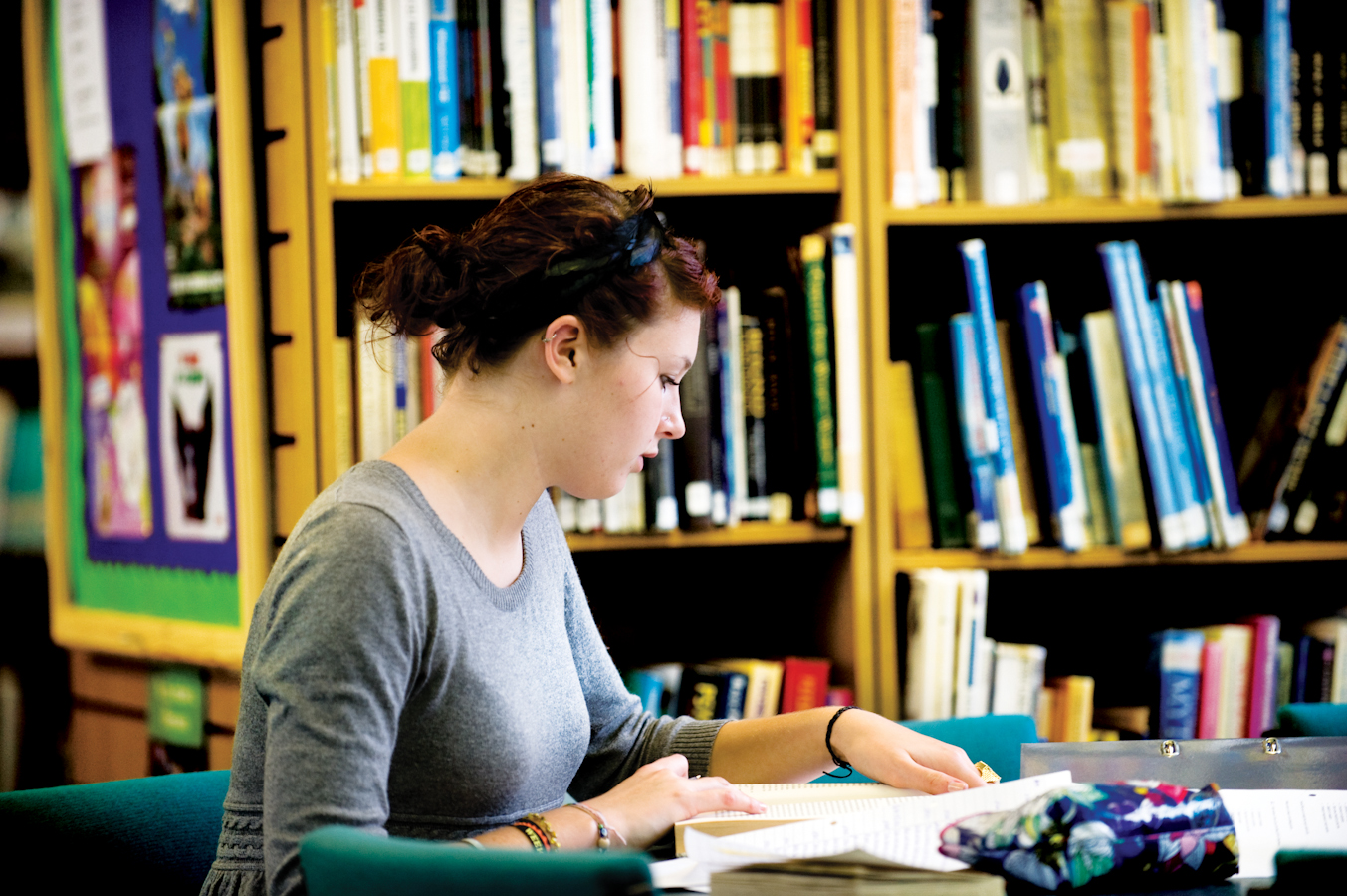 School girl studying in library
