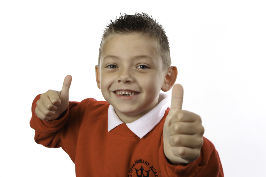 Young boy smiling and posing with thumbs up in contemporary Vancols photo shoot